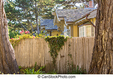 American house with wooden fence
