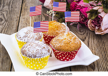 American independence day, celebration, patriotism  concept - muffins, decorated with flag  for 4th july party.