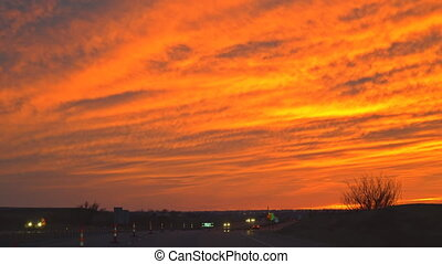 American interstate highway in busy night traffic across freeway during a wonderful sunset