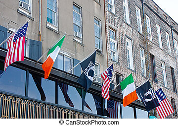 American Irish and MIA Flags on Old Building