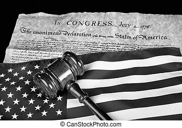 Declaration of Independence with American flag and wooden gavel in black and white.