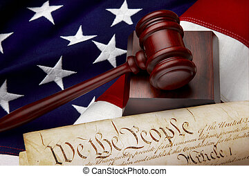 Gavel, and U.S. Constitution shot on American flag
