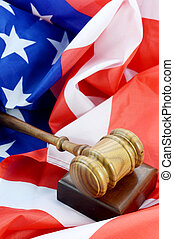American Legal System - A wooden gavel and American flag...