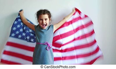 American little girl with American flag on a background....
