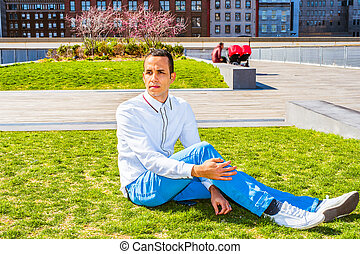 American Man Relaxing on Green Lawn in New York
