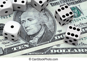 American money surrounded by dice