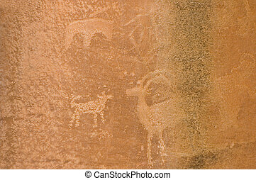 Petroglyph or rock carvings of Indians (Native Americans) on a canyon wall in Utah, USA, representing animals, figures, sheep, snakes, wilderness