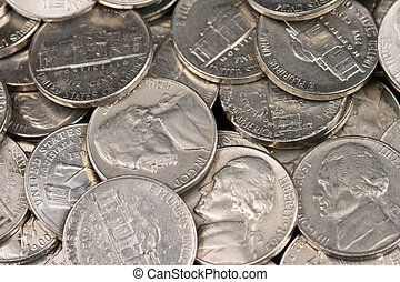 A close up shot of American nickels