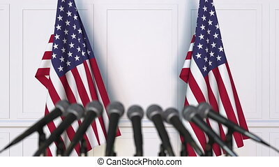 American official press conference. Flags of the United...