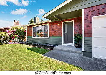 American one level house exterior with garage and well kept garden. Northwest, USA