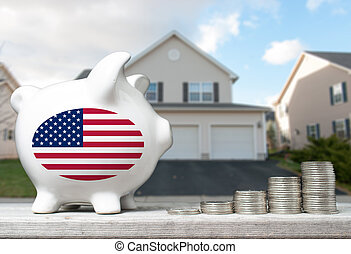 American real estate investment concept with piggy bank, stacks of coins and house in the background