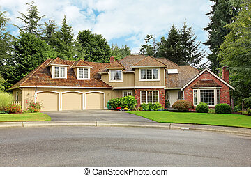 American real estate. Luxury house exterior with brick trim