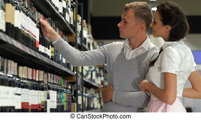 American shoppers choosing at liquor store - American...