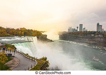 American side of Niagara Falls during sunrise . - American...