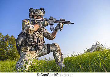 American Soldier aiming his rifle on blue sky background -...