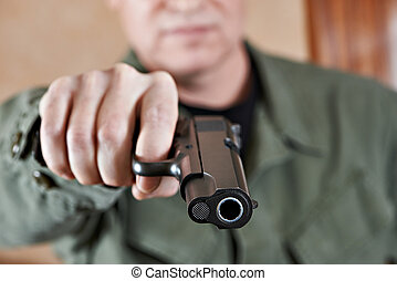 American soldier aiming pistol