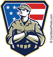 Illustration of an American solider military serviceman looking up with arms folded facing front with USA stars and stripes flag in background set inside crest shield.