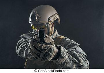 American soldier shooting at camera.