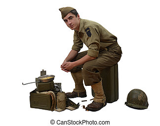 American soldier sitting on a jerrycan, he eats his meals