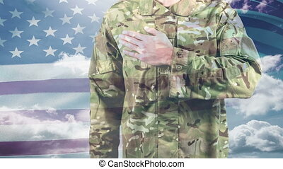 American soldier taking a pledge and American flag swaying in the background. White clouds in the sky 4K