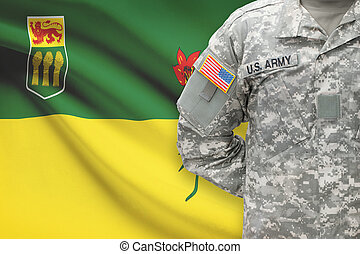 American soldier with Canadian province flag on background - Saskatchewan