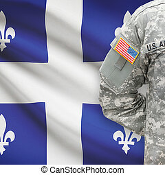 American soldier with Canadian province flag on background - Quebec