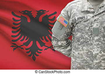 American soldier with flag on background - Albania