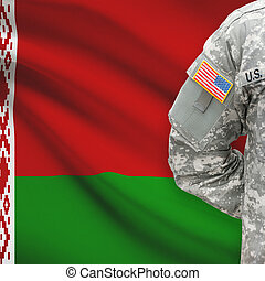 American soldier with flag on background - Belarus