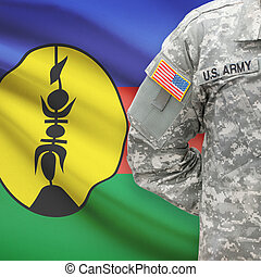 American soldier with flag on background - New Caledonia