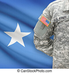 American soldier with flag on background - Somalia