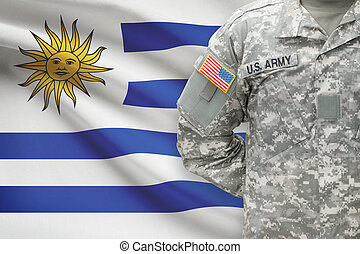 American soldier with flag on background - Uruguay
