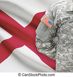American soldier with US state flag on background - Alabama