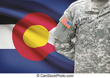 American soldier with US state flag on background - Colorado
