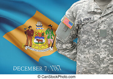 American soldier with US state flag on background - Delaware