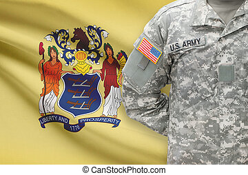 American soldier with US state flag on background - New Jersey