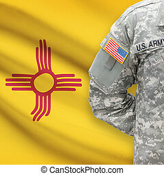 American soldier with US state flag on background - New Mexico