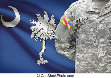 American soldier with US state flag on background - South...