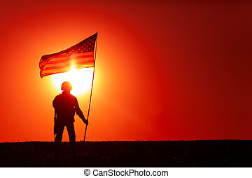American soldiers with national flag silhouette