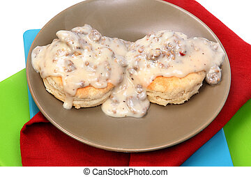 American Southern Style Sausage Biscuits and Gravy in Table...