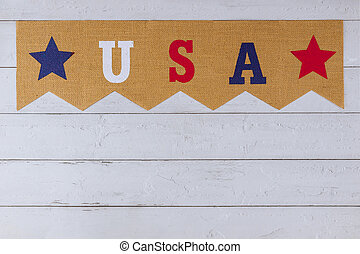 American symbol celebrating holiday USA word of letters with veterans day Memorial Day Labor Day Independence day on wood background