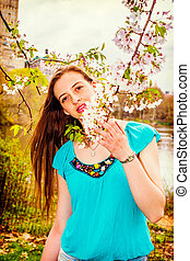 American Teenage Girl Loving flowers at Central Park in New York in spring day