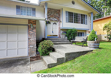 American two story house exterior with garage and double entry door
