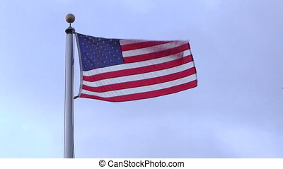 American USA Flag blowing in the Wind on a flagpole