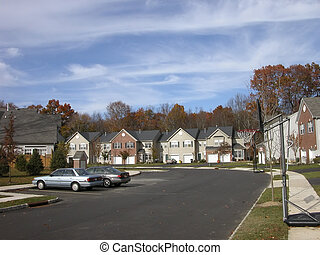 Typical american houses in a village near Princeton, NJ. Blue sky with clouds.