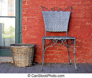 Welcome scene of americana chair and woven basket on wood and brick front porch