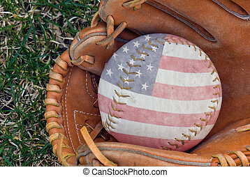 Americana - Flag design on softball in glove.