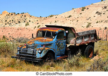 Old truck in the desert showing rusty colors