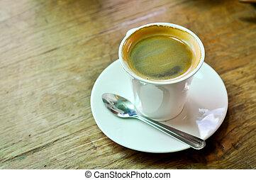 Americano - A cup of americano coffee on the table.