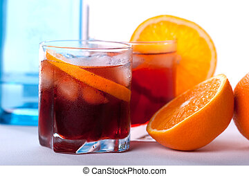 Americano and Negroni cocktails with orange