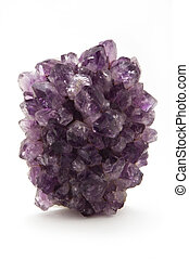 A chunk of amethyst stood on one end and isolated on a white background.